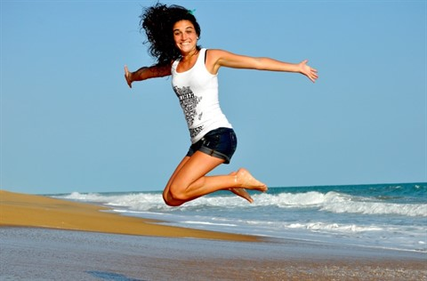 Woman-beach-jumping.jpg