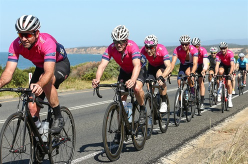 Men cycling along the Great Ocean Road