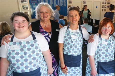 Councillor and community members with aprons