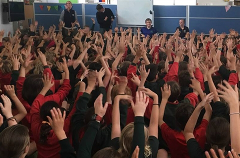 Schoolkids-with-hands-raised.jpg