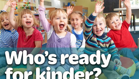 kinder kids raising hands